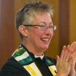 Rev Tandi clapping
