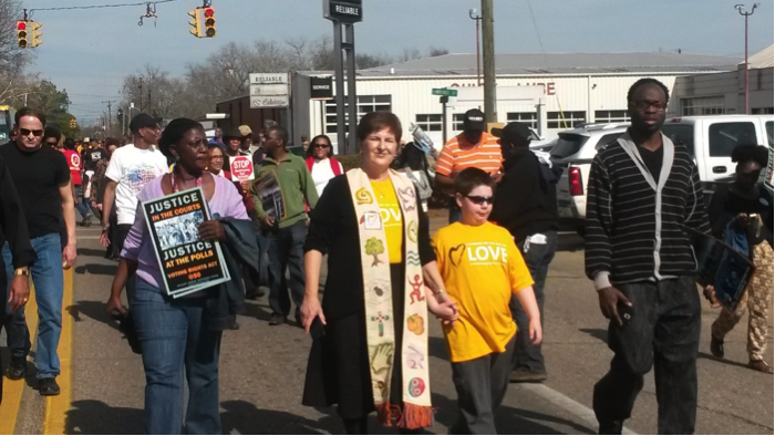 Walking toward Edmund Pettus Bridge during Selma 50th Anniversary march