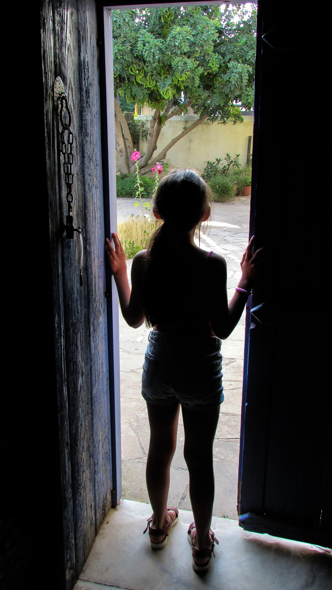 girl looking out from door