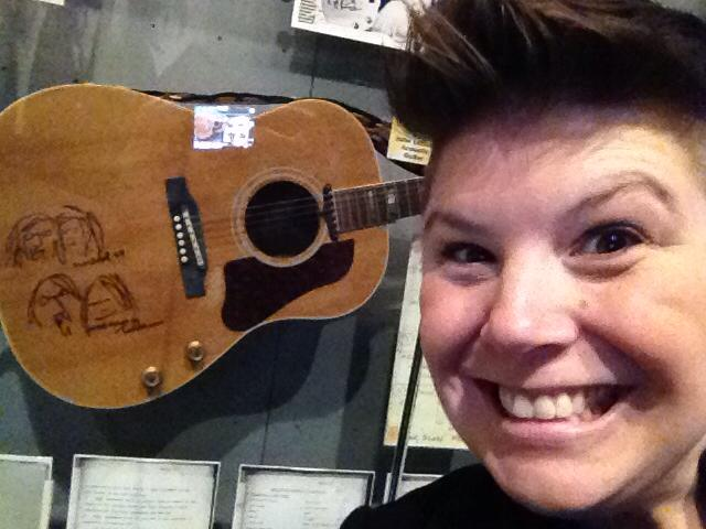 Picture of Kimberly Sweeney with Beatles guitar